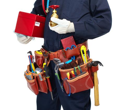 ก       tool: Handyman with a tool belt. Isolated on white background. Stock Photo
