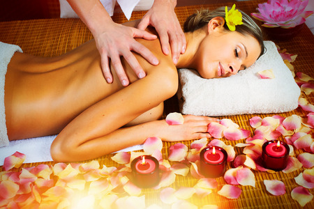 salon and spa: Beautiful woman having relaxing in spa massage salon.