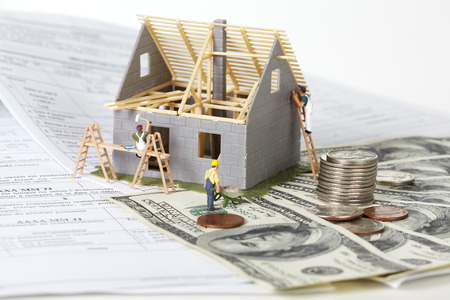 housebuilding: Family house with money. Construction background. Stock Photo