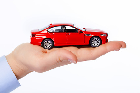 service broker: Hand with car. Auto dealership and rental concept background.