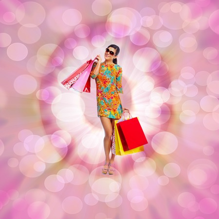 Young happy smiling woman with shopping bags  photo