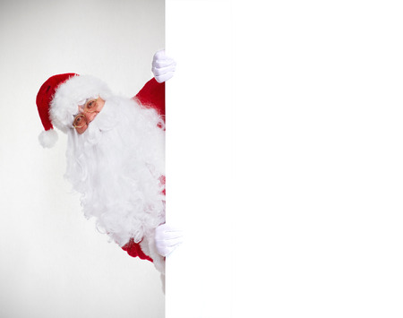 Happy Santa Claus with christmas blank banner.  Isolated on white background. photo