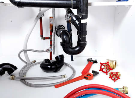 sink drain: Kitchen sink pipes and drain. Plumbing service.