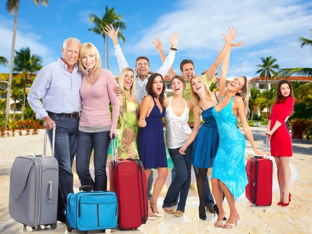 travellers: Happy people in tropical ressort. Holiday vacation background. Stock Photo