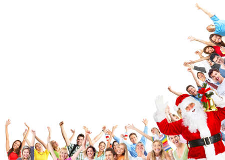 Happy people group and Santa dancing at christmas party photo