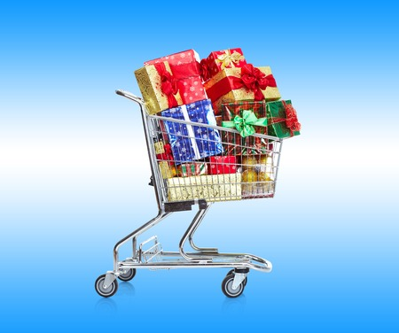 boxing day sale: Shopping cart with gifts  Christmas sale concept