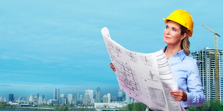 Professional Woman architect over Construction industry background. photo