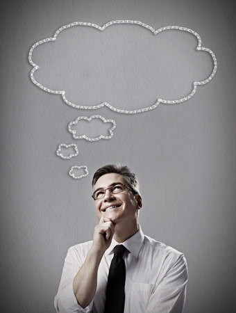 incertitude: Man thinking solution over gray dark background Stock Photo