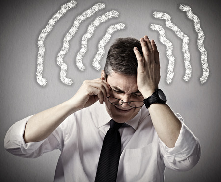 incertitude: Business man having a headache and Stress Stock Photo