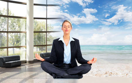 Meditation  Relaxing business woman on the beach photo