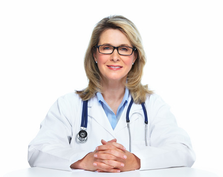 Smiling mature doctor woman. Isolated over white background. photo