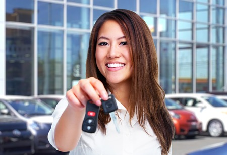Beautiful young woman with a car keys