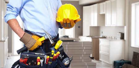RENOVATE: Handyman with a tool belt  Stock Photo