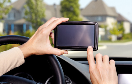 Car driver hands with GPS. Road destination. Stock Photo - 23983474