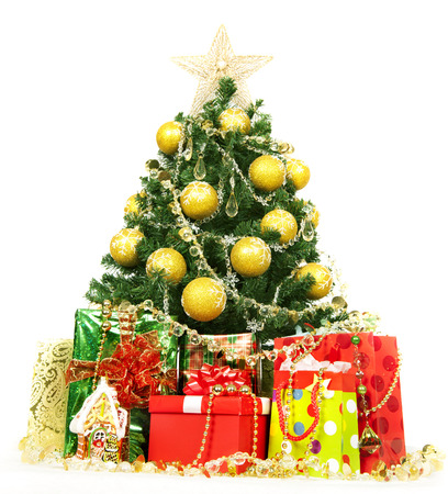 Christmas tree and gifts isolated over white background. Stock Photo - 23983475