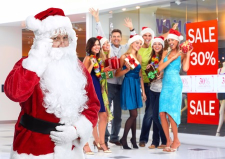 Santa Claus and group of happy people  photo