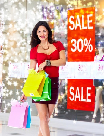 Young woman with shopping bags. Christmas sale. photo