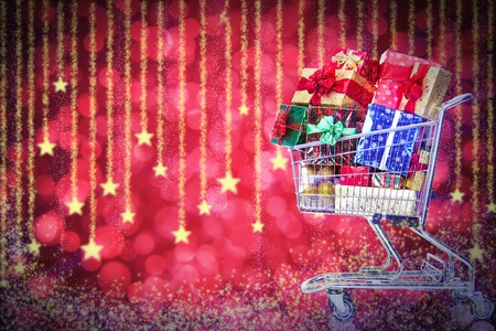 Christmas shopping cart with gifts. Boxing day. photo