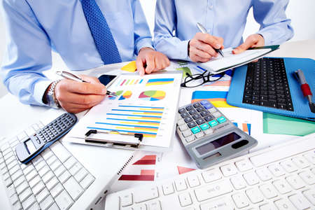 the bookkeeper: Hand with calculator. Finance and accounting business.
