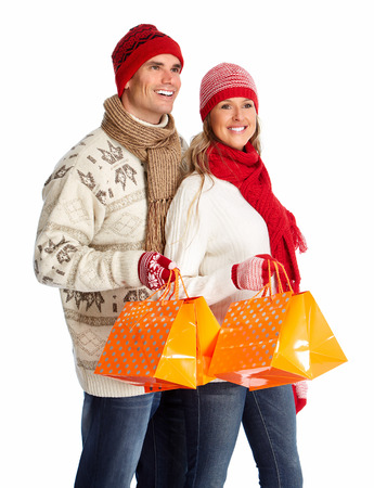 Happy shopping couple with bags. Isolated  white background. photo