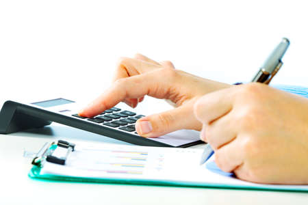 Hands of accountant with calculator and pen. Accounting background. Stock Photo