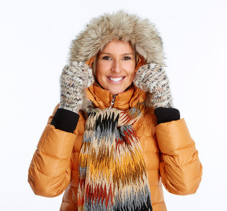 outer clothing: Young woman wearing winter coat isolated over white background Stock Photo