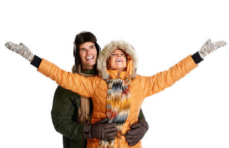 Happy couple in winter clothing isolated over white background. photo