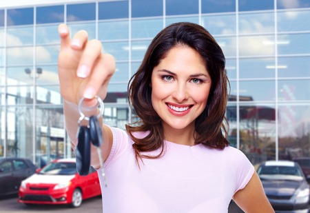 Beautiful young woman with a car keys  photo