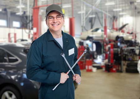 auto shop: Auto mechanic with wrench