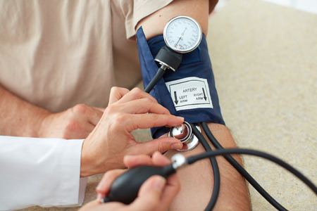 diastolic: Blood pressure measuring. Doctor and patient.  Health care.