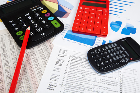 financial service: Calculator and office objects. Accounting and financial service. Stock Photo