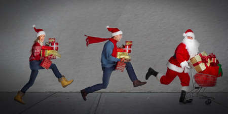 happy family shopping: Happy people running with xmas gifts  Christmas sale  Stock Photo