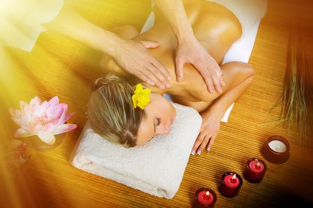 medical lighting: Beautiful woman having relaxing in spa massage salon.