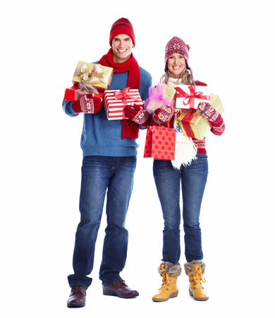 happy christmas: Happy couple with christmas present isolated over white background. Stock Photo