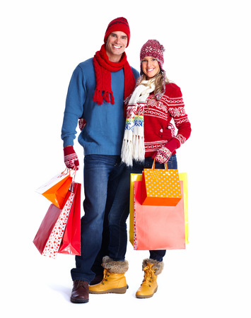 Happy couple with christmas shopping bags isolated over white background. photo