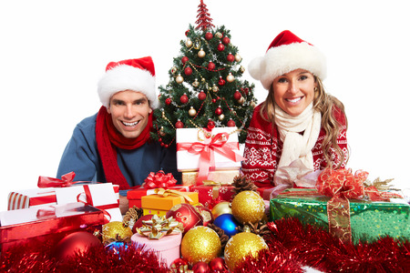Happy couple with christmas present isolated over white background  Stock Photo - 24137489