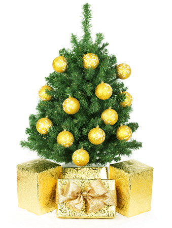 Christmas tree and gifts isolated over white background. Stock Photo - 24005471
