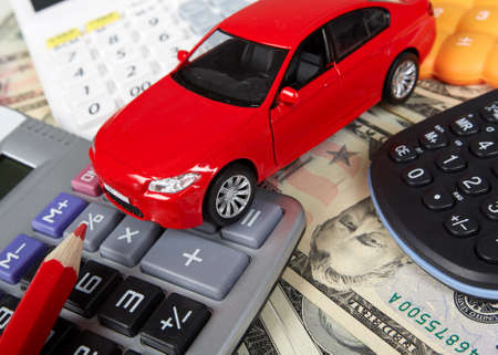 car loans: Car money and calculator. Payments and costs. Stock Photo
