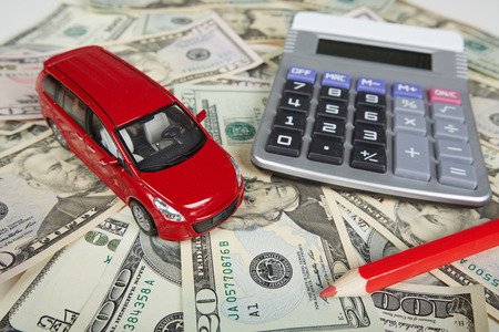 Car money and calculator. Payments and costs. photo
