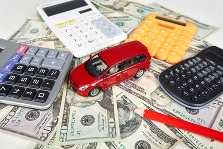 fees: Car money and calculator. Payments and costs. Stock Photo