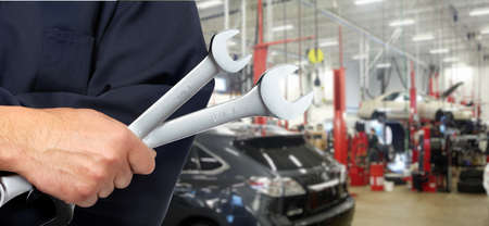 automotive repair: Hand with wrench  Auto mechanic  Stock Photo