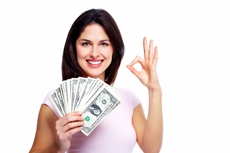 Happy young woman with money. Saving account concept. photo