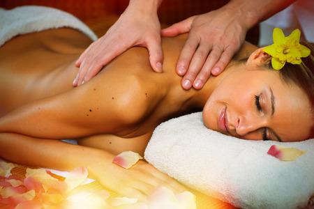Beautiful woman having relaxing in spa massage salon. photo