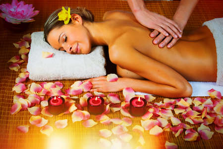 Beautiful woman having relaxing in spa massage salon. photo