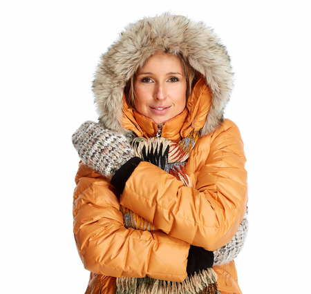 Young woman wearing winter coat isolated over white background Stock Photo