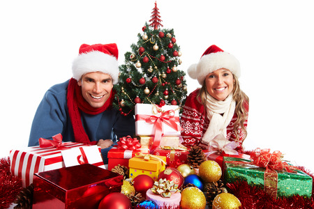 Happy couple with christmas present isolated over white background. Stock Photo - 24191965