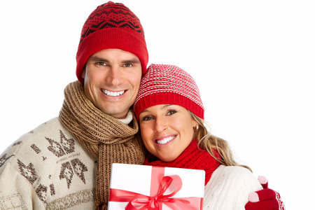 happy couple white background: Happy couple with christmas present isolated over white background. Stock Photo