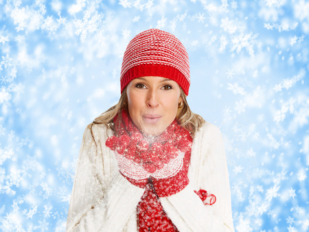 Happy woman in winter clothing over snowy background  photo