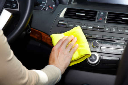 cleaning services: Hand with microfiber cloth cleaning car.