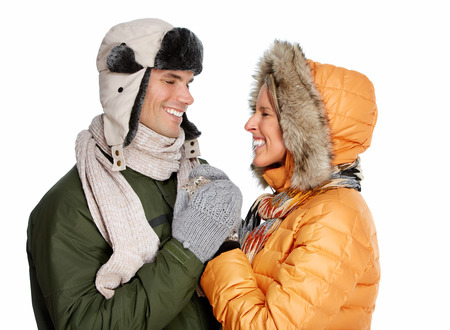 Happy couple in winter clothing isolated over white background  photo